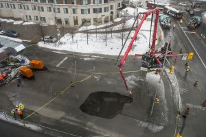 OTTAWA, ONTARIO: February 21, 2014 -- A sinkhole opened up near the University of Ottawa at Laurier Avenue and Waller Street in Ottawa on Friday, February 21, 2014. (Photo by Justin Tang/ Ottawa Citizen) (Assignment no.: 116207, Slug no.: city-sinkhole)