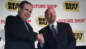 Hassan Khosrowshahi, left, chairman and CEO of Future Shop shakes hands with Richard Schulze right, chairman and CEO of Best Buy following a news conference in Vancouver Tuesday Aug. 14, 2001. It was announced Tuesday the Best Buy paid $580-million to purchase Future Shop.(CP PHOTO/Chuck Stoody)