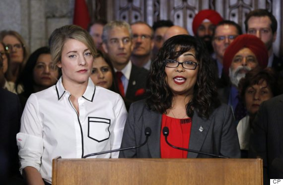 Liberal MP Iqra Khalid makes an announcement about an anti-Islamophobia motion on Parliament Hill while Minister of Canadian Heritage Melanie Joly looks on in Ottawa on Wednesday, February 15, 2017. THE CANADIAN PRESS/ Patrick Doyle